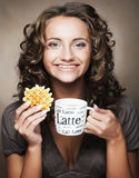 Woman with coffee and cookies Royalty Free Stock Images