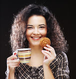 Woman with coffee and cookies stock photos