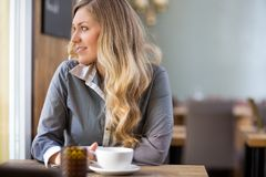 Woman With Coffee Cup At Coffeeshop Stock Photography