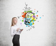Woman with coffee cup and colorful light bulb Royalty Free Stock Photos