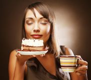 Woman with coffee and dessert Royalty Free Stock Image