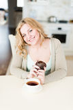 Woman with coffee and dessert Stock Image