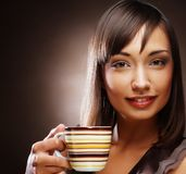 Woman with coffee and dessert Royalty Free Stock Photography