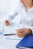 Woman with coffee filling in blank paper Royalty Free Stock Photos
