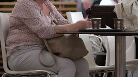 Woman with a coffee in a foodcourt stock footage