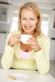 Woman with coffee at home Royalty Free Stock Photo
