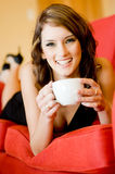Woman with coffee at home Stock Images