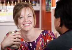 Woman in coffee house with male friend Royalty Free Stock Photos