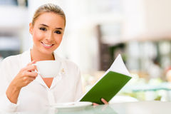 Woman at a coffee house Royalty Free Stock Photography