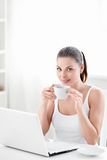 Woman with coffee and laptop Stock Photography