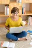 Woman with coffee and laptop Royalty Free Stock Photography