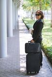 Woman with coffee and luggage Royalty Free Stock Image