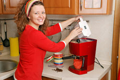 Woman with coffee machine Stock Photography