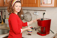Woman with coffee machine Royalty Free Stock Images