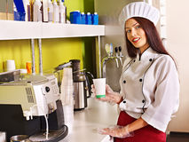 Woman with coffee machine. Stock Photography