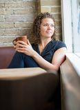 Woman With Coffee Mug In Cafeteria Royalty Free Stock Photography