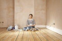 Woman With Coffee Mug Sitting On Floorboard Royalty Free Stock Photos