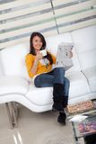 Woman with coffee and the newspaper Stock Photo