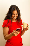 Woman with coffee and phone Royalty Free Stock Photo