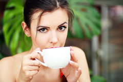 Woman with coffee stock photos