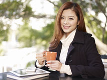 Woman in coffee shop Royalty Free Stock Photography