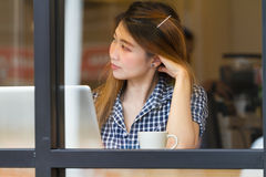 Woman in coffee shop Royalty Free Stock Image