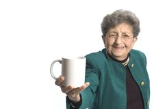 Woman with coffee tea. Attractive senior woman with cup of coffee or tea royalty free stock photos