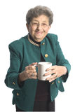 Woman with coffee tea. Attractive senior woman with cup of coffee or tea royalty free stock photo
