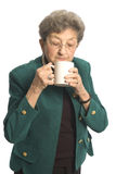 Woman with coffee tea. Attractive senior woman with cup of coffee or tea royalty free stock image