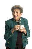 Woman with coffee tea. Senior woman drinking coffee or tea and happy stock photos