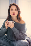 Woman with of coffee or tea at home Royalty Free Stock Photo