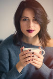 Woman with of coffee or tea at home Stock Photography