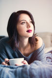 Woman with of coffee or tea at home Royalty Free Stock Photos