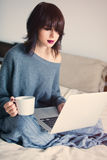 Woman with of coffee or tea and notebook Stock Photography