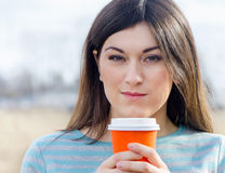 Woman with Coffee in To-Go Cup Stock Images