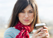 Woman with Coffee in a To-Go Cup. Stock Image