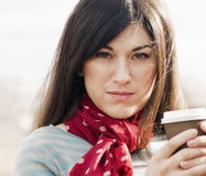 Woman with Coffee in a To-Go Cup. Royalty Free Stock Images