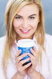 Woman with coffee to go Royalty Free Stock Photos