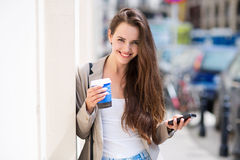 Woman with coffee to go Stock Images