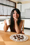 Woman with coffee and truffles Royalty Free Stock Photo