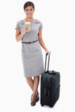 Woman with coffee and wheely bag Stock Photos