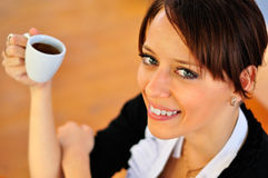 Woman with a coffee at the wooden background. Stock Image