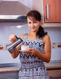 The woman with coffee Royalty Free Stock Image