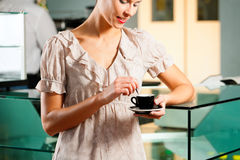 Woman in a coffeeshop Royalty Free Stock Photography