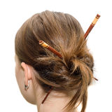 Woman coiffure with asian sticks Royalty Free Stock Images