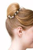 Woman coiffure with bun Stock Image