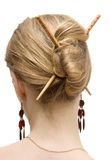 Woman coiffure with sticks Stock Photos