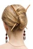 Woman coiffure with sticks stock photos