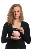 Woman with coin and piggy bank Stock Photography
