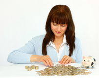 Woman with coins. Woman counting coins isolated on a white background Royalty Free Stock Photo